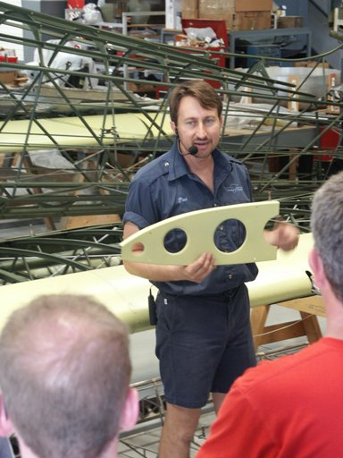 Aircraft Restoration Specialist Paul Stecewycz speaks with guests during a  tour.
